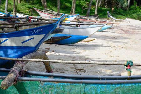 southern sri lanka: Sri Lankan boats on sandy beach in Tangalle, Southern Province, Sri Lanka, Asia.