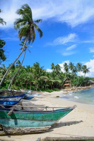 tangalle: Sri Lankan boats on sandy beach in Tangalle, Southern Province, Sri Lanka, Asia.