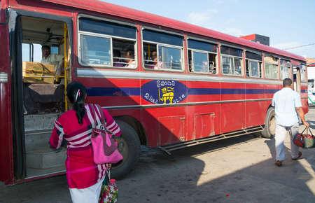 tangalle: TANGALLE, SOUTHERN PROVINCE, SRI LANKA - DECEMBER 15, 2014: Red bus in Tangalle on December 15 2014 in Tangalle, Southern Province, Sri Lanka, Asia.