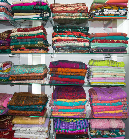 tangalle: TANGALLE, SOUTHERN PROVINCE, SRI LANKA - DECEMBER 17, 2014: Colorful fabrics on display in a store on December 17, 2014 in Tangalle, Southern Province, Sri Lanka, Asia. Editorial