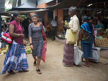southern sri lanka: TANGALLE, SOUTHERN PROVINCE, SRI LANKA - DECEMBER 17, 2014: Rat poison and vegetable vendors in the market on December 17, 2014 in Tangalle, Southern Province, Sri Lanka, Asia.