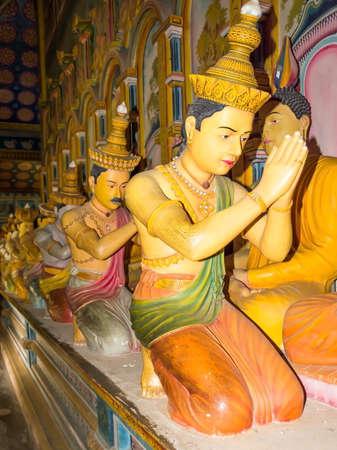 DICKWELLA, SOUTHERN PROVINCE, SRI LANKA - DECEMBER 20 2014: The twenty-eight Buddhas. Interior of buddhist monastery Wewurukannala Vihara with Buddha statues in Dickwella, Southern Province, Sri Lanka, Asia.