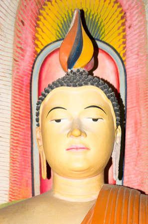 DICKWELLA, SOUTHERN PROVINCE, SRI LANKA - DECEMBER 20 2014: Buddha closeup. Interior of buddhist monastery Wewurukannala Vihara with Buddha statues in Dickwella, Southern Province, Sri Lanka, Asia.