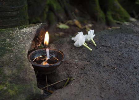 wewurukannala: Flowers and oil burning. Ceremonial flowers and oil burning arrangement, Sri Lanka, Asia.