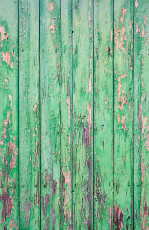 flaked: Shabby wooden door with flaked green paint. Stock Photo