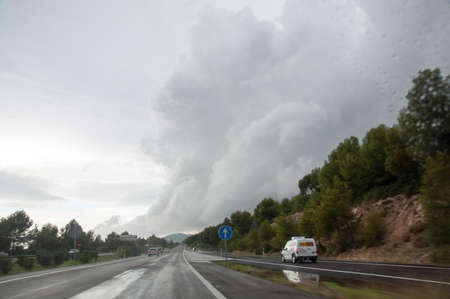 torrential: Dramatic cloud bringing torrential rains in Majorca in November, on the freeway heading west between Palma and Andratx. Editorial
