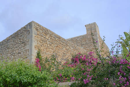 without windows: Drystone Building Without Windows and pink bougainvillea. Mallorca, Balearic islands, Spain. Editorial