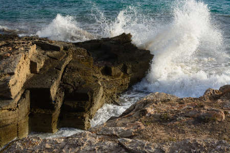 breaking wave: Breaking wave in Ses Covetes, southern Majorca.