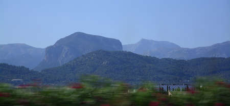 pla: Tramuntana mountains in Majorca seen from the road with speed blur in July.
