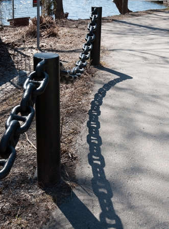 chain fence: Black chain fence with interesting shadow pattern, Solna, Sweden.