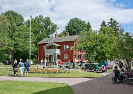 karlstad: ALSTER, KARLSTAD, SWEDEN - JUNE 20, 2014: People at Midsummer celebrations and Norwegian - Swedish wedding on June 20, 2014 in Alster, Karlstad, Sweden.