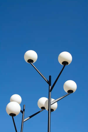functionalism: Round fifties lamps with white opaque glass globes on black metal posts - fifties modernist suburb Vallingby, Stockholm, Sweden.