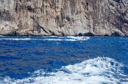onboard: MALLORCA, BALEARIC ISLANDS, SPAIN - JULY 19, 2014: Jetskiers  speeding in seaspray on July 19 2014 in southwestern Mallorca, Balearic islands, Spain. Editorial