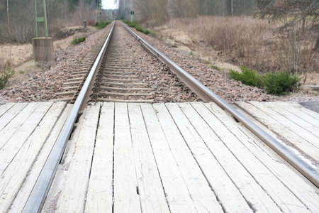 wood railroads: Railroad tracks perspective Stock Photo