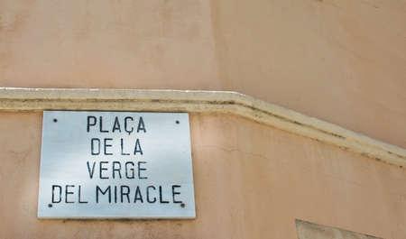 miracle: Street sign by Miracle Place - Placa de la Verge del Miracle - in Santa Catalina. Palma de Mallorca, Balearic islands, Spain.