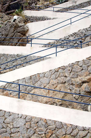drystone: PORT DE SOLLER, MALLORCA, SPAIN - APRIL 22, 2015: Zigzag pattern on staircase seen from the side with drystone wall on April 22, 2015 in Port de Soller, Mallorca, Balearic islands, Spain.