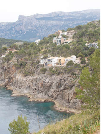 inlet bay: PORT DE SOLLER, MALLORCA, SPAIN - APRIL 22, 2015: Attractive first line real estate on the steep slopes by the bay inlet on April 22, 2015 in Port de Soller, Mallorca, Balearic islands, Spain.