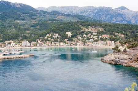 inlet bay: PORT DE SOLLER, MALLORCA, SPAIN - APRIL 22, 2015: Bay view of the small village from the inlet on April 22, 2015 in Port de Soller, Mallorca, Balearic islands, Spain.