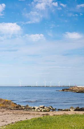 windy energy: FALKENBERG, SWEDEN - JUNE 5, 2015: Wind power turbines and natural heath on June 5 in Falkenberg, Sweden. Editorial