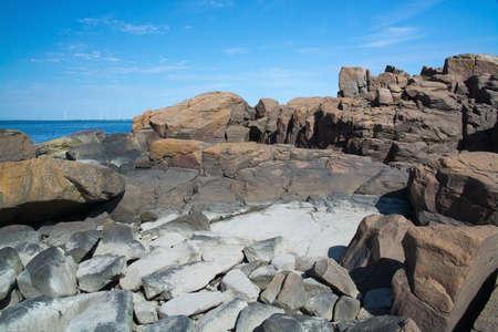beach landscape: Rocky sandy beach landscape and blue sky in Falkenberg, Sweden.