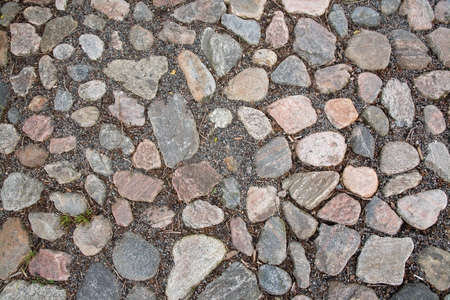 road surface: Cobble stone road surface texture for background copy space.