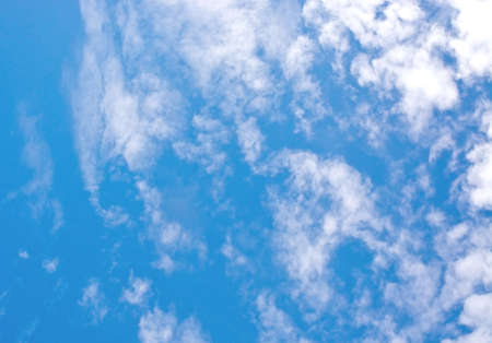 windy: Gray and white clouds on blue sky in windy weather.