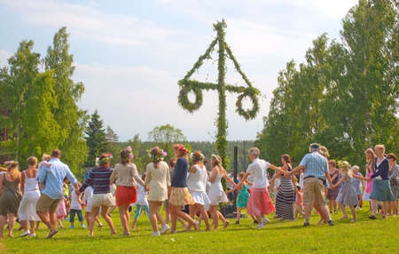 AKERSBERGA STOCKHOLM SWEDEN: JUNE 21 2013: Dance around Midsummer pole on June 21 2013 in Akersberga Stockholm Sweden