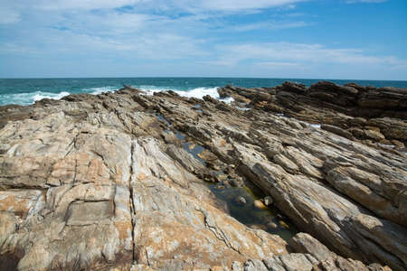 metamorphic: Rocky coast landscape with metamorphic rocks and splashing foaming waves Southern Province Sri Lanka Asia.