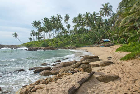rocky point: TANGALLE SRI LANKA  DECEMBER 19 2015: Beach with small colorful light wood boats on the Rocky Point beach on December 19 2015 in Tangalle Sri Lanka.