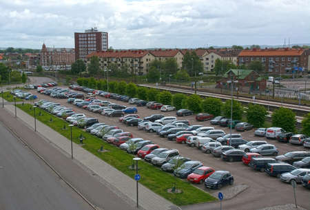 parking station: HALMSTAD SWEDEN  JUNE 8 2015: Car parking by the train station on June 8 2015 in Halmstad Sweden. Editorial