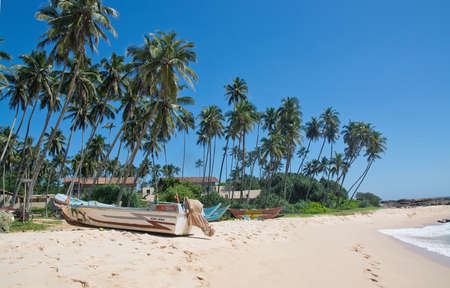 rocky point: TANGALLE SRI LANKA  DECEMBER 14 2015: Beach with small colorful light wood boats on the Rocky Point beach on December 14 2015 in Tangalle Sri Lanka. Editoriali