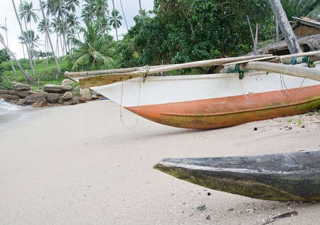 rocky point: TANGALLE SRI LANKA  DECEMBER 21 2015: Beach with light wood boats on the Rocky Point beach on December 21 2015 in Tangalle Sri Lanka.