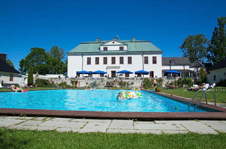magnate: HANINGE, STOCKHOLM, SWEDEN - JULY 2, 2015: Haringe Castle, steeped in rich history previously owned by Swedish match magnate family Krger, in front of the swimming pool on a sunny summer day on July 2, 2015 in Haninge, Stockholm, Sweden. Editorial