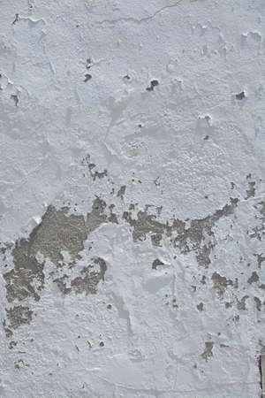 roughcast: White distressed vintage grungy roughcast or stucco wall for background texture or copy space in vertical format in Mallorca, Balearic islands, Spain.