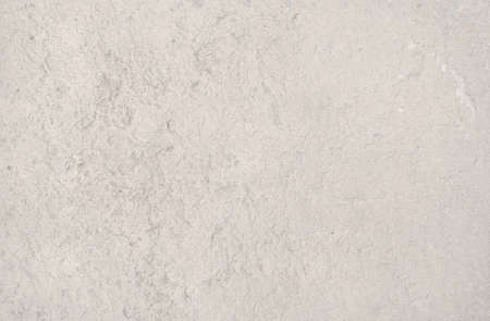 roughcast: Cream color distressed vintage grungy roughcast or stucco wall for background texture or copy space in horizontal format in Mallorca, Balearic islands, Spain.