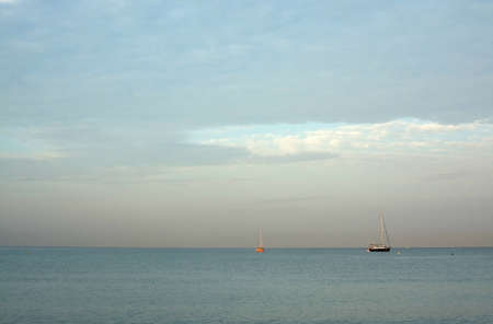 strawberry blonde: CAN PASTILLA, MAJORCA, BALEARIC ISLANDS, SPAIN - JULY 21, 2015: Two sailboats moored in bay at dawn on July 21, 2015 in Can Pastilla, Mallorca, Balearic islands, Spain. Editorial