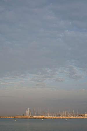 masts: CAN PASTILLA, MAJORCA, SPAIN - JULY 21, 2015: Can Pastilla marina at dawn. First sun rays hitting the masts in the marina at dawn on July 21, 2015 in Playa de Palma near Can Pastilla in Mallorca, Balearic islands, Spain.