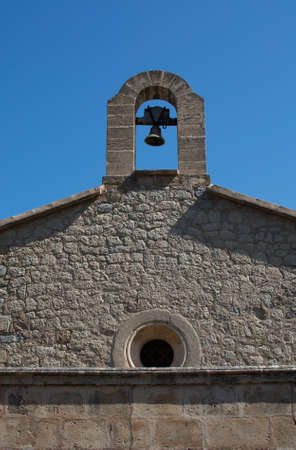 the campanile: MONASTIR DE MIRAMAR, MAJORCA, SPAIN - JULY 24, 2015: Medieval campanile with belfry at the monastery of Miramar on July 24, 2015 in Mallorca, Balearic islands, Spain. Stock Photo