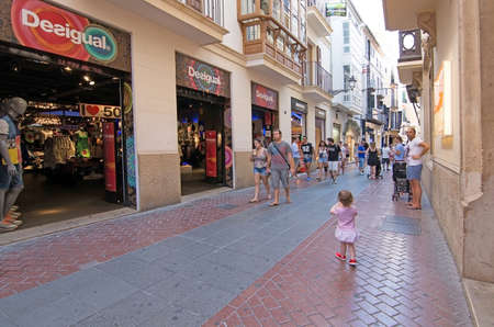 carrer: PALMA DE MALLORCA, BALEARIC ISLANDS, SPAIN - JULY 22, 2015: Pedestrian street view with people on Carrer Sindicat on a sunny summer day on July 22, 2015 in Palma de Mallorca, Balearic islands, Spain in July.