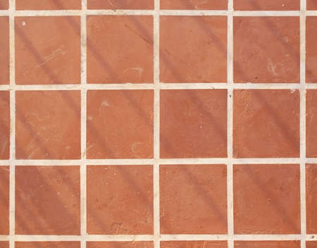 Terracotta floor square tile background texture in mallorca