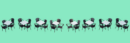 dark pastel green: White cafe tables and dark brown rattan chairs in a row on a pastel green background.