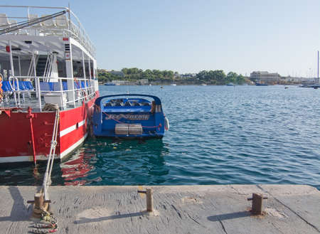tour boats: SLIEMA, MALTA - SEPTEMBER 15, 2015: Tour boats in the Sliema Ferries terminal on a sunny afternoon on September 15, 2015 in Sliema, Malta.