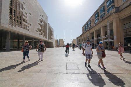 wembley: VALLETTA, MALTA - SEPTEMBER 15, 2015: Pedestrians walk in streets of Valletta outside Art Center on a sunny day in September 15, 2015 in Valletta, Malta.
