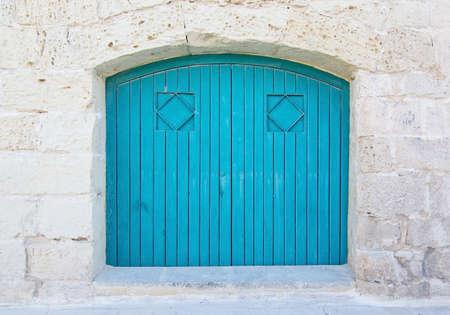 door knob: Turquoise blue wood door. Painted doors of Malta series.