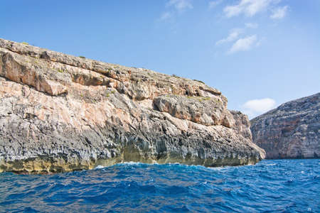 limestone caves: Limestone rocks with caves and clear turquoise water of popular tourist attraction Blue Grotto on a sunny day in September 15, 2015 in Malta.
