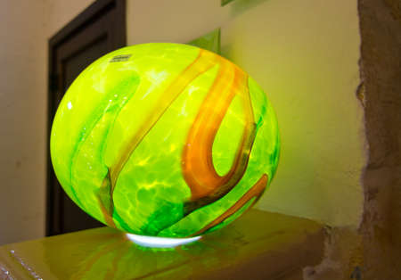 artisanry: MDINA, MALTA - SEPTEMBER 15, 2015: Handblown glass lamp in green made by artisans in Mdina on display in Mdina glass store on September 14, 2015 in Mdina, Malta.