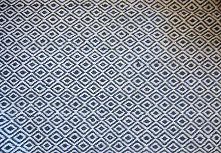 floor covering: Black and white floor covering wool rug in classical pattern background.