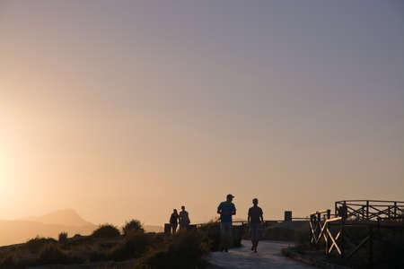 rollerblade: MALLORCA, BALEARIC ISLANDS, SPAIN - JULY 21, 2014: People jog and rollerblade along the coast outside Palma de Mallorca in a hazy sunny summer evening at dusk on July 21, 2014 in Mallorca, Balearic islands, Spain. Editorial