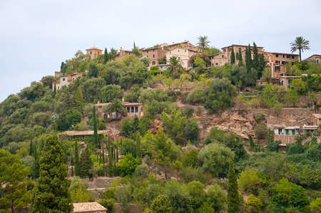 drystone: Lush hills near Deia with traditional drystone buildings on an overcast day in July in Mallorca, Balearic islands, Spain.