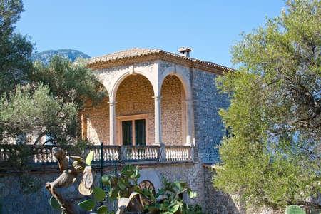mirador: MIRADOR, MALLORCA, BALEARIC ISLANDS, SPAIN - JULY 26, 2015: Mirador building exterior among trees on July 26, 2015 in Mallorca, Balearic islands, Spain in July.